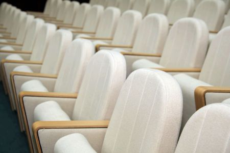 Empty seats in a large conference room