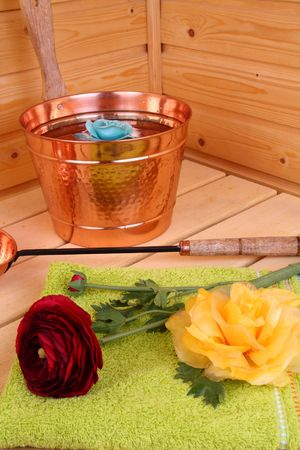 Interior of a Finnish sauna with flower and towel photo