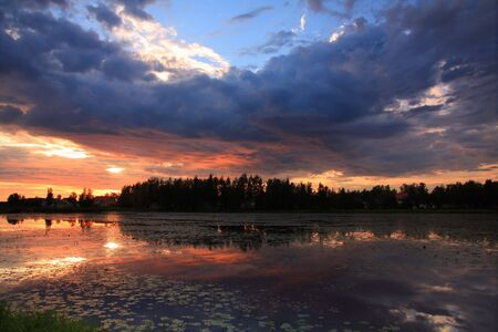 Lake at sunset with reflection in Finland
