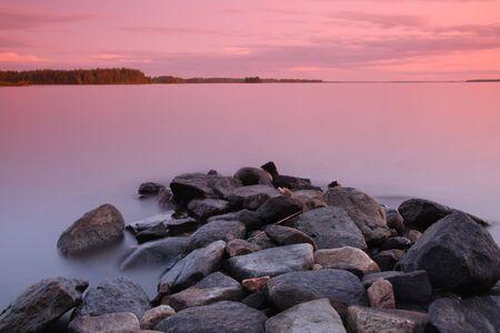 long lake: Sunset by the lake, rocks, long exposure