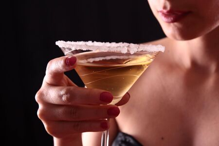 Beautiful young woman holding a martini glass Stock Photo