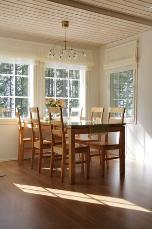 Interior of a home, dining room in sunlight Stock Photo