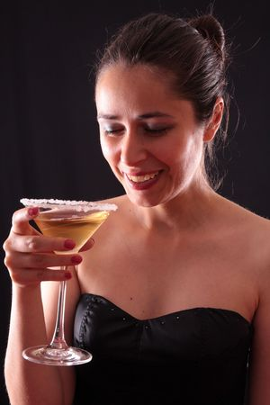 Beautiful young woman holding a martini glass Stock Photo - 3845279
