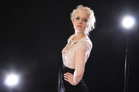 backlights: Beautiful blond fashion model posing in studio with backlights