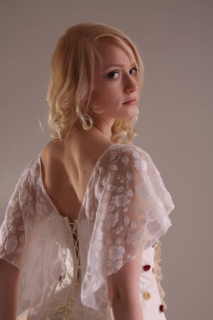 Beautiful model wearing a wedding dress, studio Stock Photo