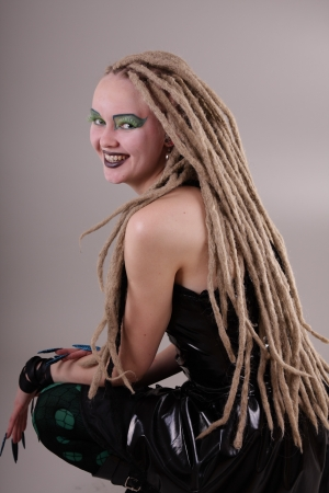 dread: Young woman with dread locks and punk clothing Stock Photo