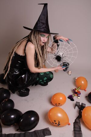 Young woman with pumpkin and Halloween setting photo