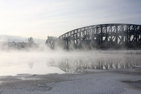 Very cold day, view over a river and bridge photo