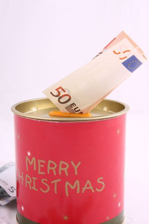 christmas savings: Christmas savings, euro bills and coins with velvet decorations