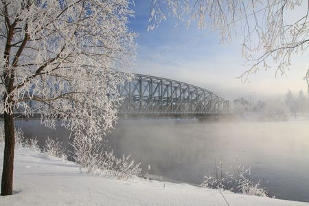 very cold: Very cold day, view over a river and bridge