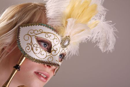 Beautiful young woman with Venetian mask, studio photo photo