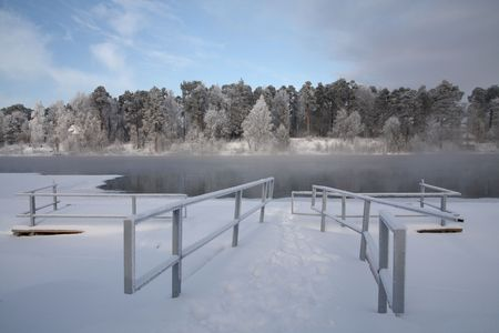 Very cold day, view over a river in Finland photo