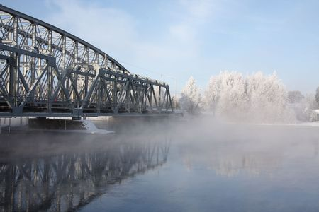 Very cold day, view over a river and bridge Stock Photo - 5866164