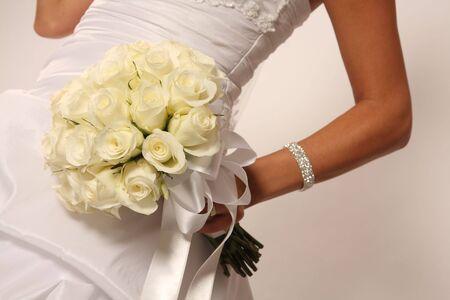 Bride and bouquet, closeup photo