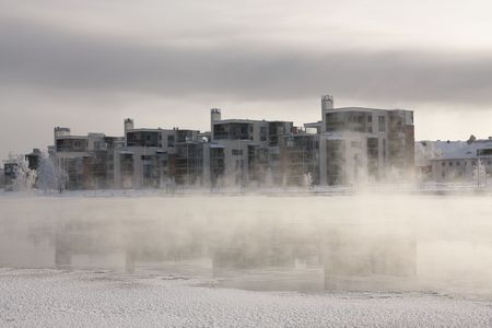 Very cold day, view over a river in Finland Stock Photo - 5918526