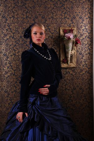 Young woman posing in victorian dress photo