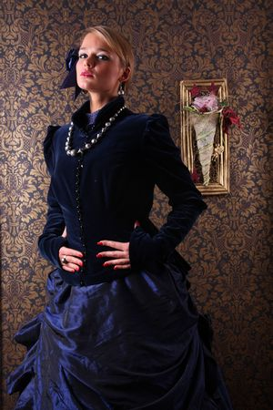 historical clothing: Young woman posing in victorian dress