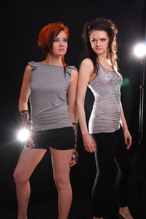 backlights: Two young models posing in the studio with backlights