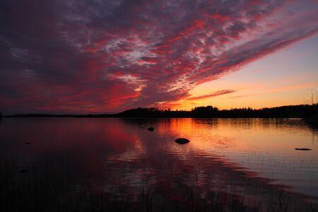 Финляндия: Beautiful lake sunset in Finland in the summer Фото со стока