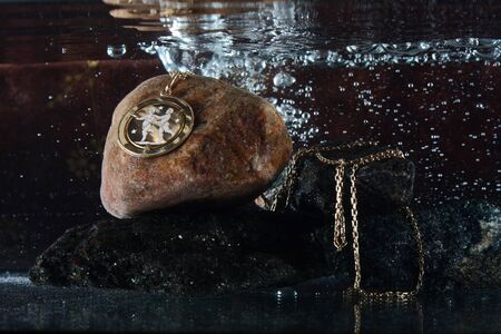 brilliant   undersea: Necklace with gemini sign underwater on black stones