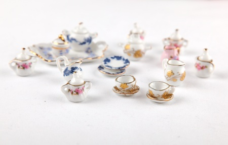 Collection of miniature tea set from a dollhouse photo