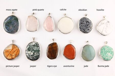 aventurine: Collection of colorful different gemstone pendants with sterling silver Stock Photo