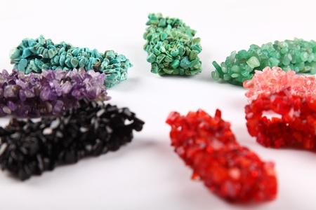 black onyx: Collection of gemstones bracelets in rainbow colors Stock Photo