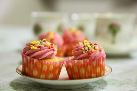 pink sweet raspberry vanilla cupcakes and teacups photo