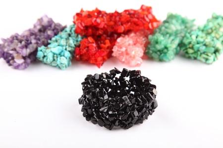 black onyx: Onyx chips black bracelet with other bracelets in background
