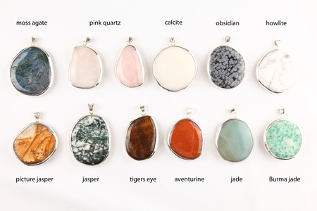 Collection of colorful different gemstone pendants with sterling silver Stock Photo