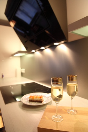 Champagne glasses in beautiful modern kitchen