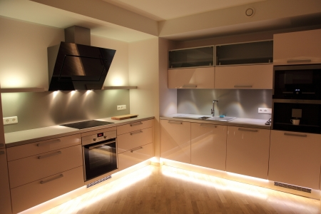 stainless steel kitchen: Beautiful modern nordic kitchen with modern lighting Stock Photo