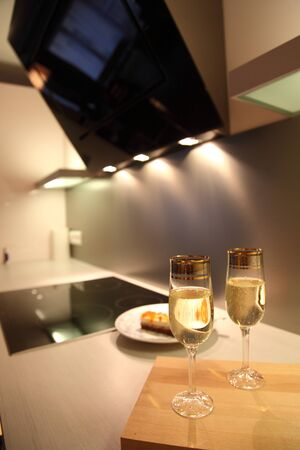 Champagne glasses in beautiful modern kitchen photo