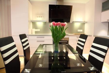 Beautiful modern nordic kitchen with modern lighting and fresh flowers Stock Photo - 16192165