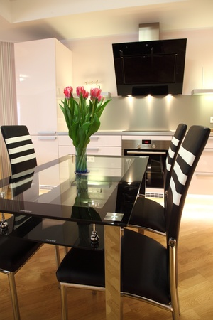 Beautiful modern nordic kitchen with modern lighting and fresh flowers photo