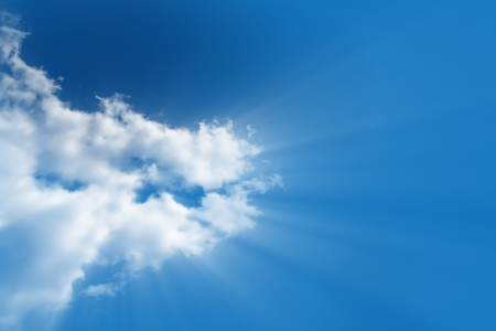 hallowed: A bright white cloud from which the divine light rays flows in a clear, bright blue sky