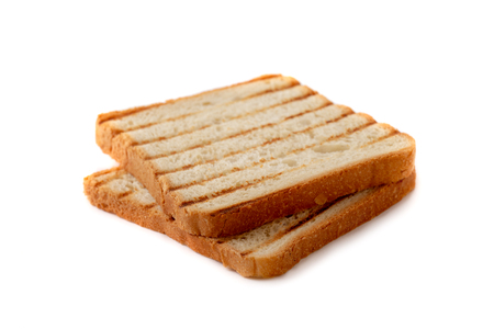 Slices of toast bread grilled with a golden crust isolated on white background