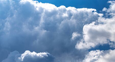 Massive cumulus cloud formation at the bright blue sky, soft fluffy background Stok Fotoğraf
