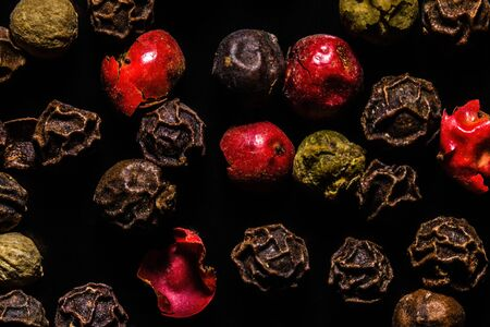 Colored dried pepper mix on a dark background, macro, close-up
