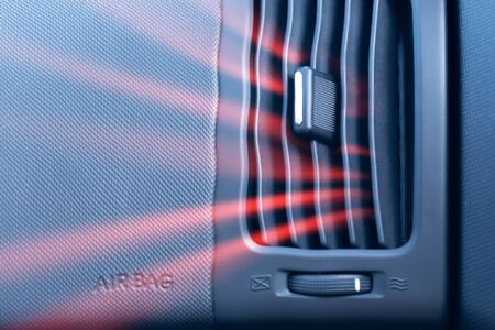 Car air conditioner with passenger airbag and illustration of hot air flow from it. Front view close up Фото со стока