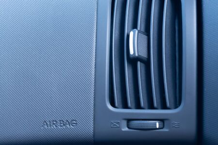 Car air conditioner with passenger airbag. Front view close up