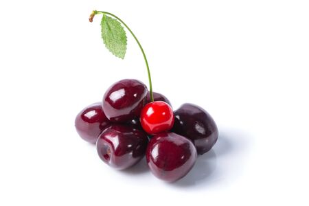 Ripe sweet cherries and one red cherry isolated on white background
