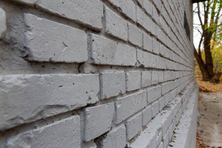 Gray brick wall. Photo background texture, close-up perspective view Фото со стока