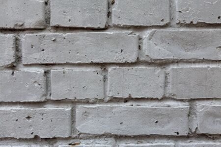Gray brick wall. Photo background texture, close-up front view