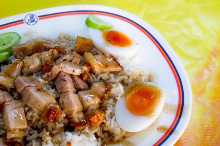 sinful: fried streaky pork and egg with rice Stock Photo