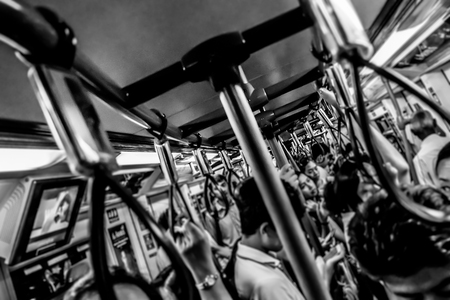 blur monochrome a lot of people hanging on the train Crowded transportation hustle concept