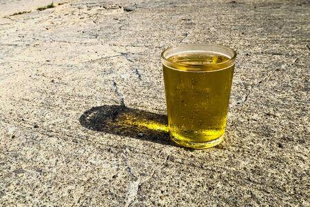Glass of cold beer sitting on street in summer Zdjęcie Seryjne