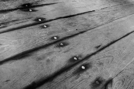weathered planks on the ground