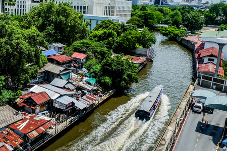 panoramic view of Poor housing along a canal on the outskirts of Bangkok