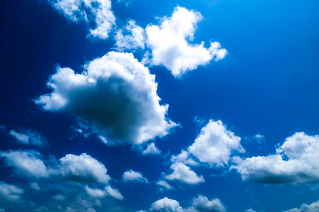 Bright blue sky and cumulus clouds on a summer day